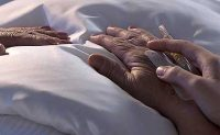 hands of person in bed